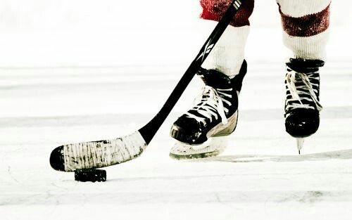 Hockey stick and skates