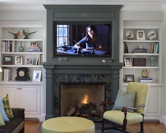 I have probably already pinned this, but just in case... ;) The fireplace with tv above it, flanked by shelves and storage, is perfect!