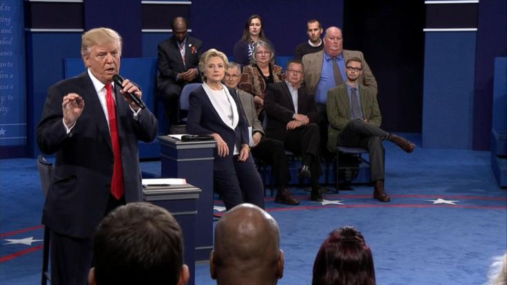 Headline: A Trump Debate Response Sparks A New Hashtag #MuslimsReportStuff Caption: Presidential nominees Hillary Clinton and Donald Trump listen to a question during the town hall debate at Washington University on Oct. 9, 2016 in St Louis, Missouri. URL: http://abcnews.go.com/Politics/trump-debate-response-sparks-popular-hashtag-muslimsreportstuff/story?id=42700608