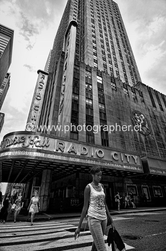 woman crosswalk Radio City Music Hall New York