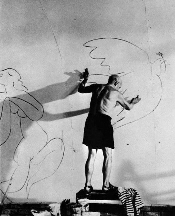 Pablo Picasso drawing a dove of peace on a wall in his studio, 1955 #art