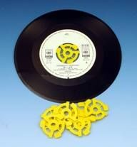 Spiders! Essential when I used to buy recent singles on Chesterfield market. They usually had the centres punched out for using on juke boxes. I never owned a yellow spider, though. Very flashy.