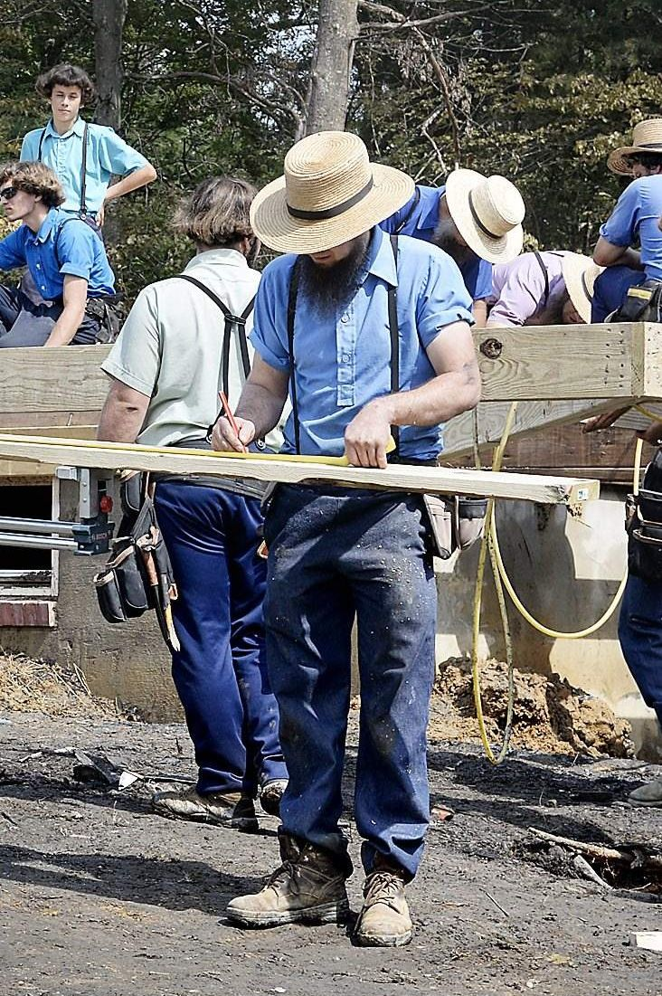 "Amish carpenter at work - looks like the group might all just be at a ""barn raising"""