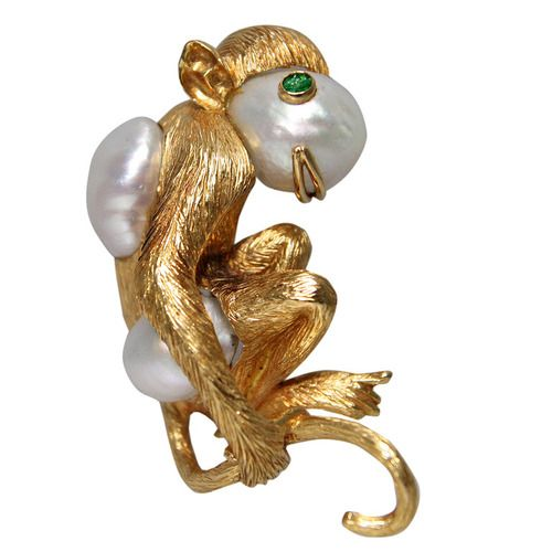 1980s David Webb Gold and South Sea Pearl Monkey Brooch. David Webb monkey brooch set with 3 south sea cultured pearls, and a cabochon emerald eye. The gold is very finely finished.