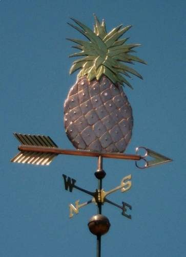 Swell Bodied Style Pineapple Weather Vane by West Coast Weather Vanes.  The body of the pineapple featured on this page is made of copper and the pineapple's leaves and the arrow tip and fletching are made of brass.