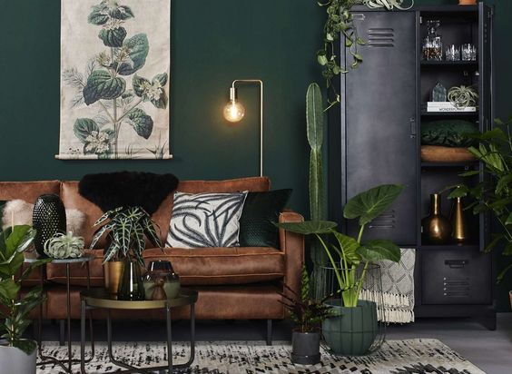 Modern Scandinavian Living Room With Green Walls And Interior And Brown Leather Sofa