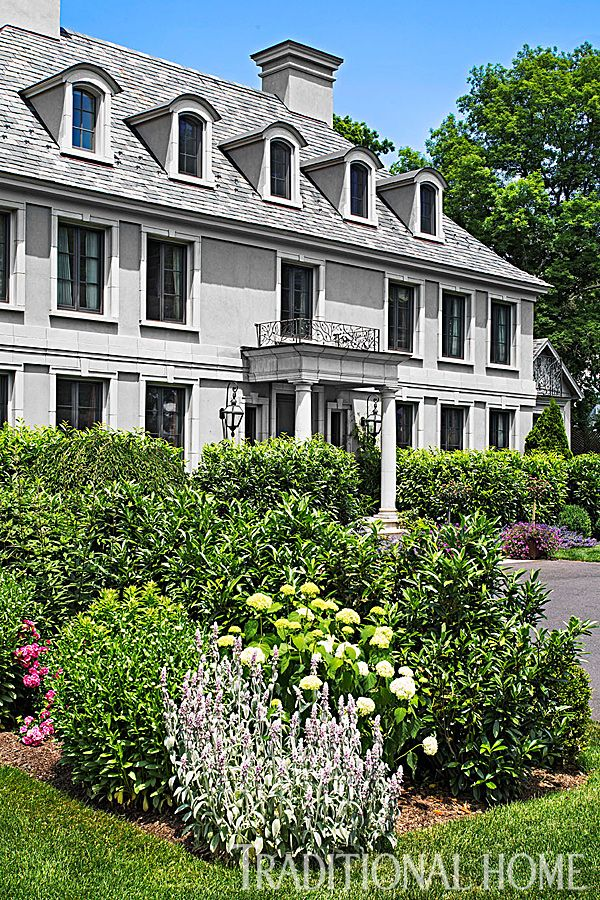 Stucco painted a taupe-tinted gray gives this Connecticut home a French feel. - Photo: John Bessler and Jonathan Wallen / Architect: Dinyar Wadia