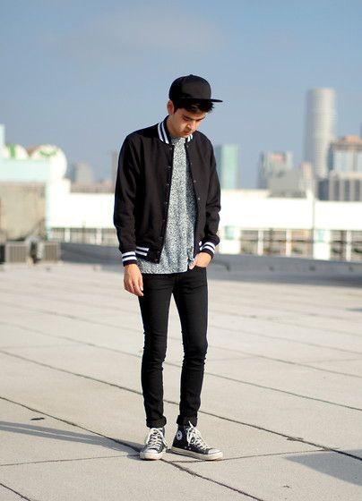 Wearing black converse high tops