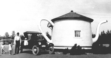 The Teapot Dome Service Station was originally located on Hwy. 410 between Zillah and Granger.  It was handcrafted by Jack Ainsworth in 1922.  He built it inspired by the Harding Administration Teapot Dome Scandal.  The store next to the Teapot was the Old Dalton Trading Co. General Country Store built by Jack Ainsworths' father in 1902.  In 1928 Mr. and Mrs. A.J. Thomas purchased the Teapot.  They operated the gas station along with a store fountain built on the same site.