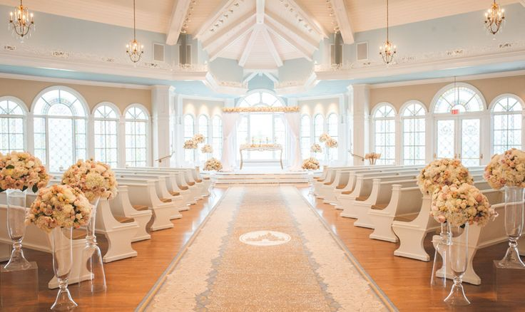On the shores of Seven Seas Lagoon, Disney's Wedding Pavilion at Walt Disney World Resort in Florida is an indoor ceremony venue with views of Cinderella Castle.