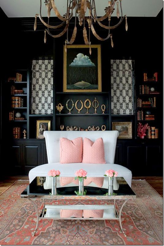 Dramatic black wall sets off the pale pink accents |black |pink |dramatic