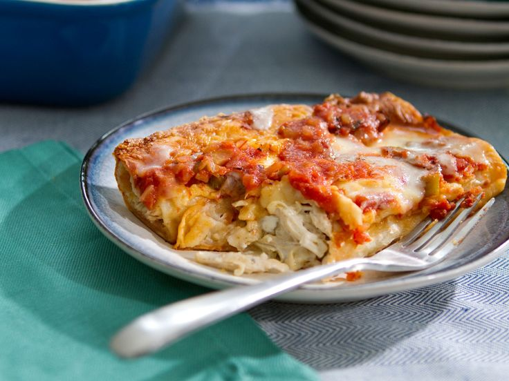 Chicken Enchiladas : Trisharoasts chicken breasts with a simple seasoning, then shreds the meat and combines it with a bold chile-cream cheese mixture, which guarantees rich flavor in the filling.