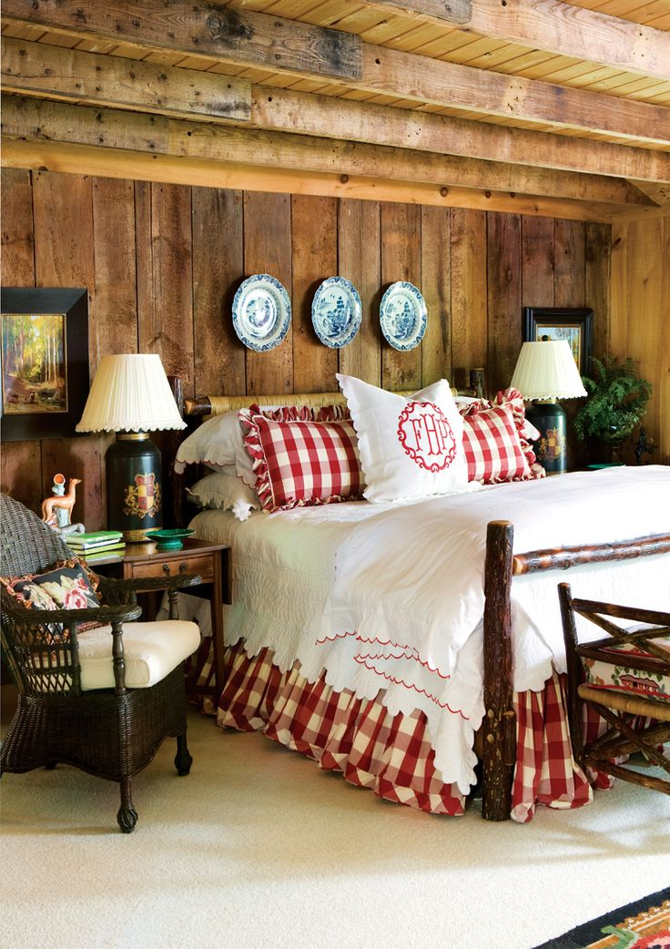 Wood walls and beams, red and white buffalo check, blue and white porcelain, monogrammed sham - Cashier's Showhouse, 2010