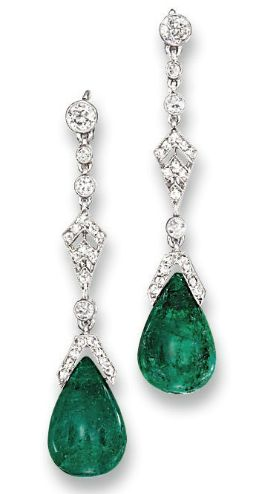 Cartier ~ A Pair of Belle Epoque Emerald and Diamond Ear Pendants. Each suspending an emerald drop to the rose-cut diamond cap and kite-shaped panel with diamond collet connecting links and circular-cut diamond surmount, circa 1915, 4.3 cm long, in fitted cream leather Cartier case. Numbered.