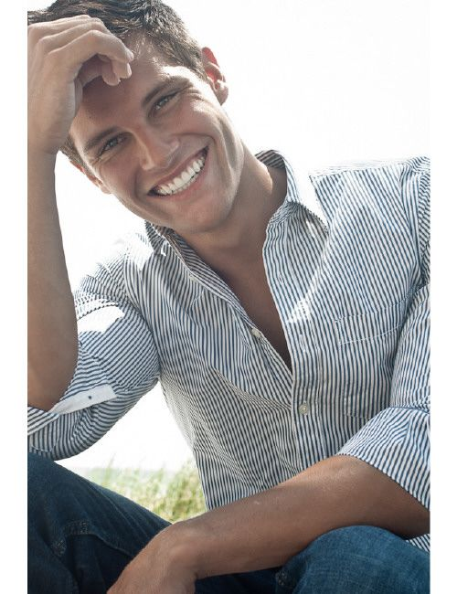 gorgeous pose and smile for a senior male session