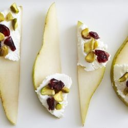 #Pear slices with #goat cheese, #cranberries, and #pistachios.