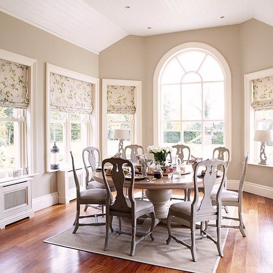 neutral dining room with arched window dining room