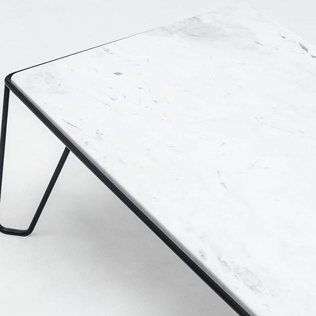 Symbiotic merge of materials. YILMAZ coffee table combining marble table top and a frame made of powder-coated steel.