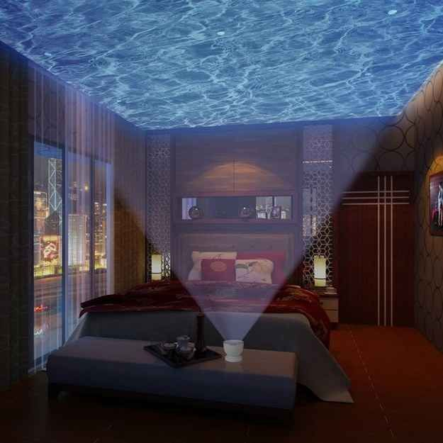 Dive into bed under the projected glow of the ocean.  I need all of these!!