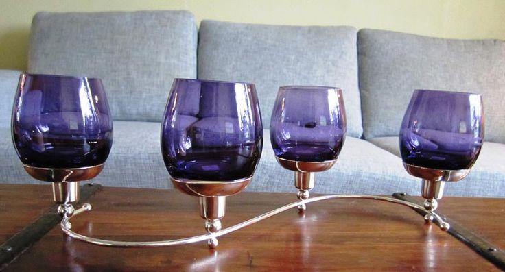 violetin väriset kynttiläsomisteet