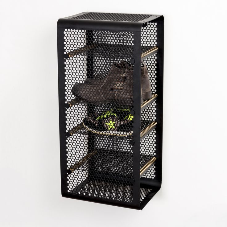 Black tica | copenhagen shoe rack. Made of metal with fine cut patterns and poles in lacquered bamboo. The shoe rack can be hung in two ways, either the shelves front or the shelves parallel to the wall. #danishdesign #entrence #tidy #shoestorage #storage #clean