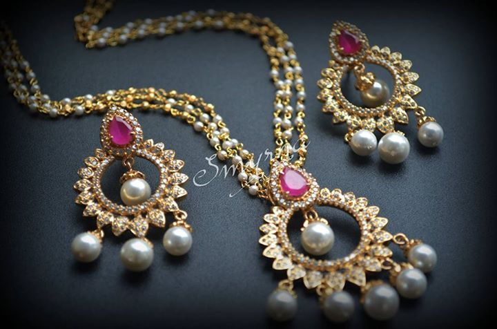 Chandbalis and pendant with peals,rubies and czs
