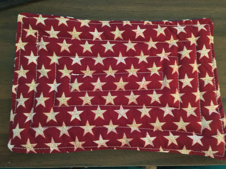 Mug Rug made with antique looking country red star material.