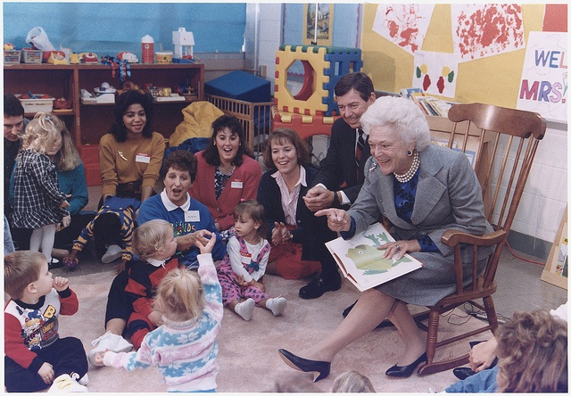 "Mrs. Barbara Bush and Missouri Governor John Ashcroft attend a ""Parents as Teachers"" parent/child group at the Ferguson-Florissant School District in Florissant, Missouri where Mrs. Bush reads ""Brown Bear Brown Bear"" to the children, 10/16/1991."