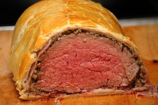 ive been wanting to make beef wellington ever since i started watching hells kitchen...i love chef ramsay!! well i finally made it last night for valentines dinner and i have to say it came out wonderful!     heres the recipe he uses on the show along with two additions i made (the shallots And garlic).    this isnt a difficult recipe its just time consuming with the wait times, but remember that most of the steps can be done in advance.