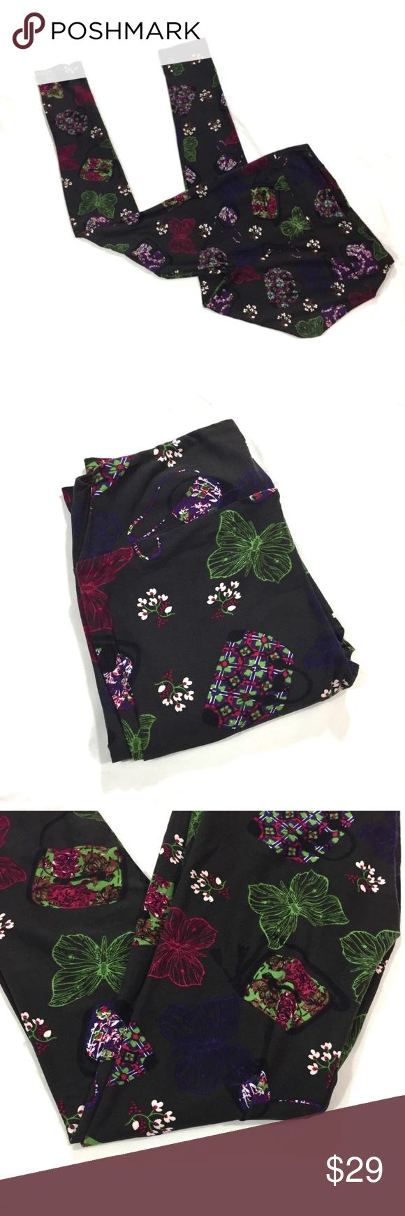 LuLaRoe OS LEGGINGS FLORAL PURSES BUTTERFLIES 🦋 Very pretty LuLaRoe one size leggings NWOT.  These have a butterfly and floral purses print on a brown background.  The brown is VERY dark- I originally thought it was black.  I haven't seen any other leggings with this print on the brown background. LuLaRoe Pants Leggings