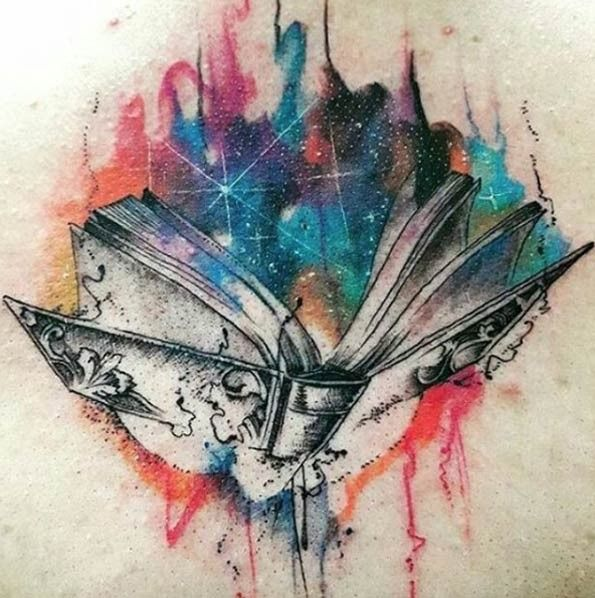 Watercolor style painted mystical magic book tattoo stylized with colorful shine