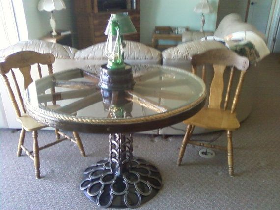 top 25 best wagon wheel table ideas on pinterest wagon wheel decor milk can table and cool tables