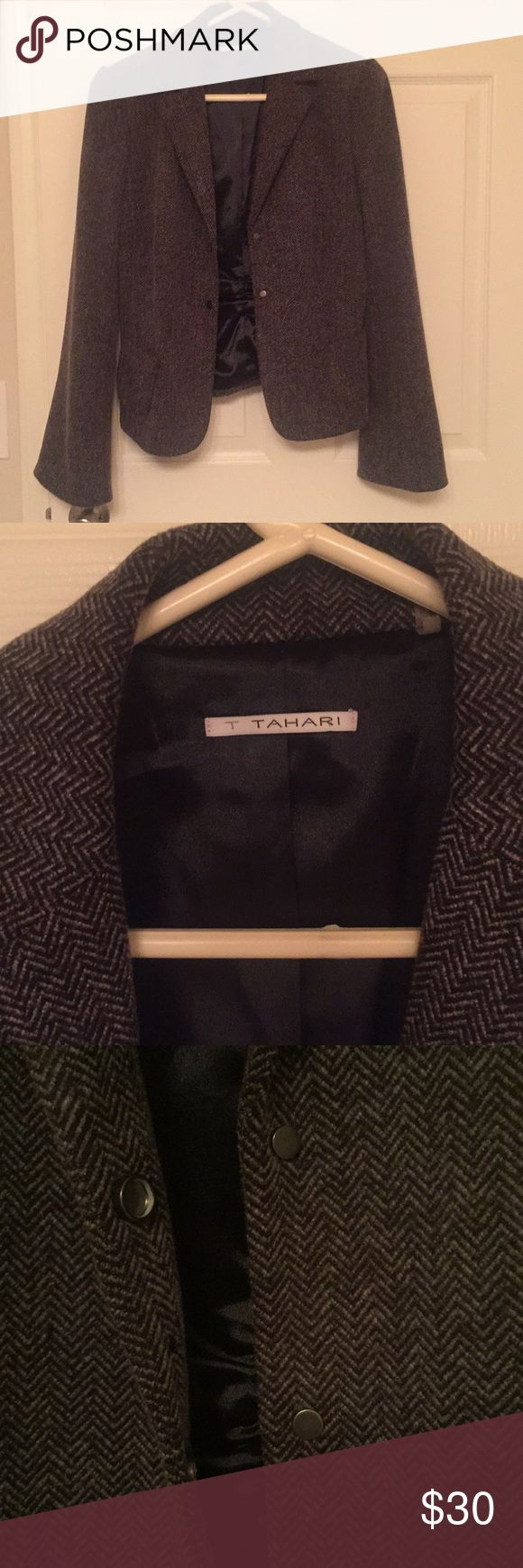 T Tahari Herringbone Jacket T Tahari gray herringbone jacket. Worn a few times - it's in good condition, like new. It is a size 8 and has bell sleeves. The material is soft and allows for movement. T Tahari Jackets & Coats Blazers
