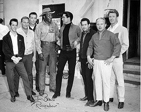 """Elvis with Jim Brown on the movie set """"Roustabout"""" with members of the Memphis Mafia - Billy Smith is far left. 