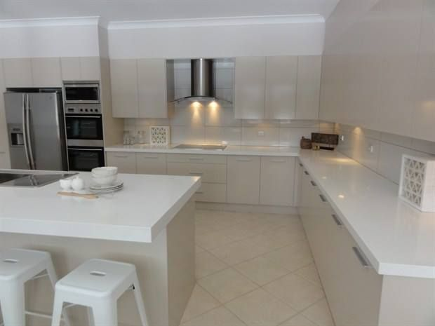 Another After shot - Granite Transformations Products Featured - Trend Surfaces benchtop in Bianco Real. Kitchen Splashback in Trend Surfaces Ghiaccio tiles