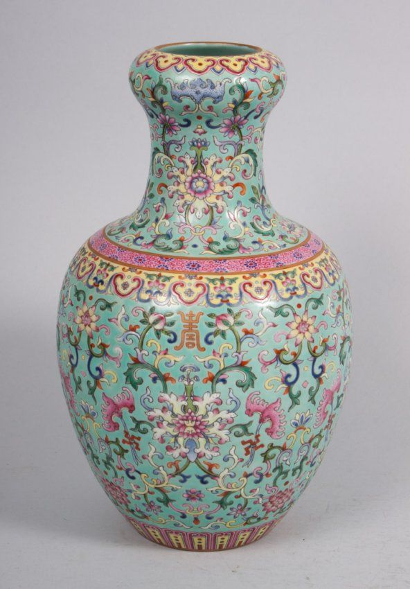 Chinese Famille Rose porcelain vase with floral and calligraphy decoration and character mark underneath, 11 in. H.