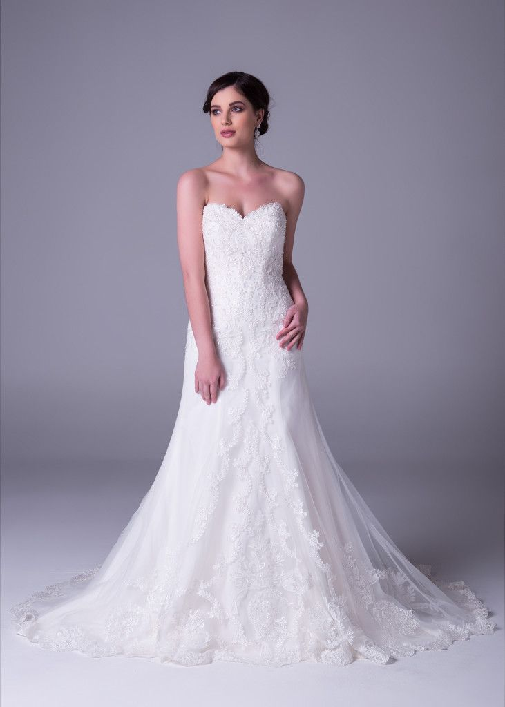 There's something about a woman in her #wedding #dress that makes for unforgettable memories. Style >> WPD17650 Click to book a free fitting in this #strapless #sheath #lace #wedding gown - only available at Bride&co South Africa stores.
