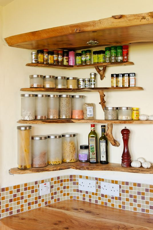 Love this spice shelf idea...  Natural edge wood kitchen shelves at the Mud and Wood House - www.mudandwood.com