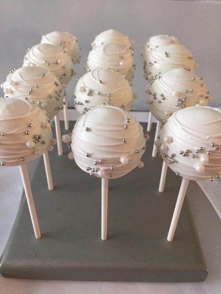 12 white dipped cake pop with white drizzle and silver and white pearls!!! I can make these cake pops to match any theme!! Each cake pops comes wrapped in a crisp cello bag and tied with the ribbon color of your choice!! Need more or less than 12 cake pops?? Please convo me and I will get a listing set up for you!!! Thanks and I look forward to doing business with you!!