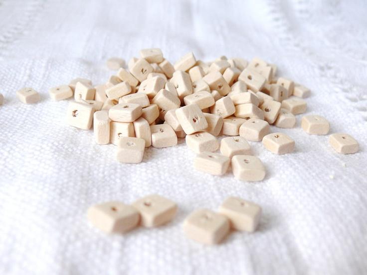 9x7 mm natural wooden rectangular beads 25 pcs eco friendly. $ 0.80, via Etsy.