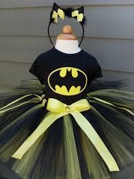 Slap the bat symbol on the front of a black or yellow swim suit and VIOLA! Batman-girl!  Batman female costume