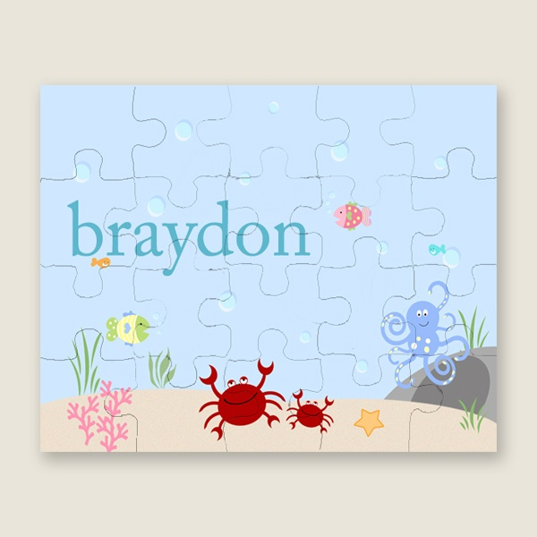 """Our personalized puzzles make great birthday gifts and stocking stuffers. Each featuring the child�s name on of our unique designs. Puzzles are printed in color on matte label with gloss film lamination then transferred to 100pt. chipboard. There are 20 pieces per puzzle. They are packaged in a reusable cardboard box with gloss label. Assembled puzzle size is 8"""" x 10""""."""