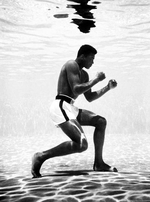 Cassius Clay (Muhammad Ali) in a swimming pool 1961