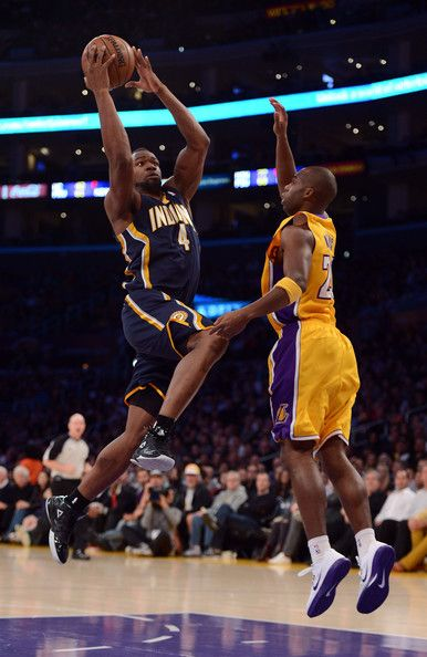 Sam Young #4 of the Indiana Pacers scores on a layup by Jodie Meeks #20 of the Los Angeles Lakers at Staples Center on November 27, 2012 in Los Angeles, California.