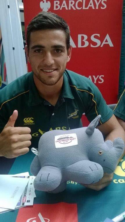 Rhino posing with SA Boks player!