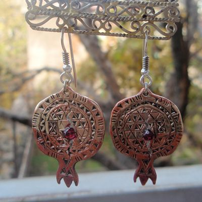 Handcrafted pomegranate earrings of copper and garnet. Designer: Ludwig (Armenia). The crack in the pomegranate design indicates ripeness symbolizing fertility.