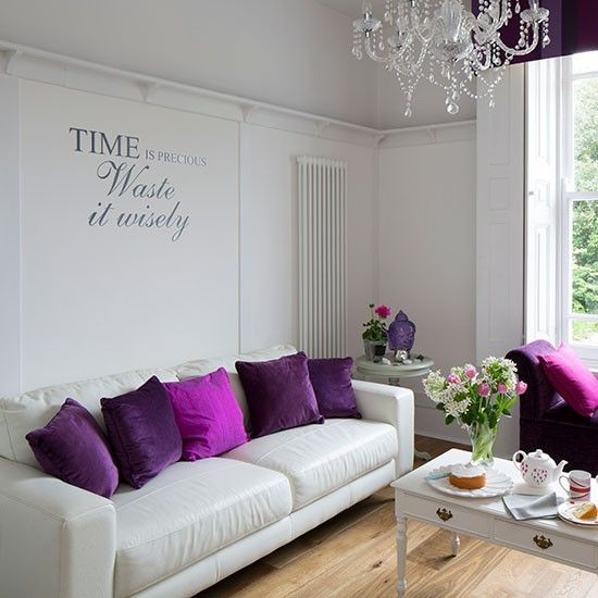 Simple White Living Room With Purple Cushions