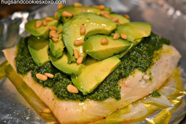 Halibut with Pesto, Avocado & Pignoli Nuts ~ Easy and delicious! Season halibut with salt, pepper and small pats of butter. Broil for 14 minutes and spread pesto on top. Top with avocado slices and sprinkle with pignoli nuts. Garnish with lemon and enjoy!