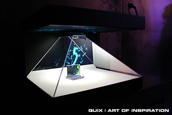 Holographic Stand is a portable projection shop window where a logo or a product is displayed as a three-dimensional virtual object which can be set into motion or made a part of an animation. The dancing 3D animation will catch the attention of everyone passing by. The holographic stand is an elegant presentation medium during events, as well as a spectacular item to be displayed in office space. Besides rental options, we can also produce the stand according to your specified dimensions.
