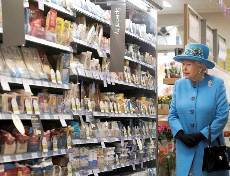 Britain's Queen Elizabeth looks at products on the shelves at a Waitrose supermarket during a visit to the town of Poundbury, 27 October 2016..